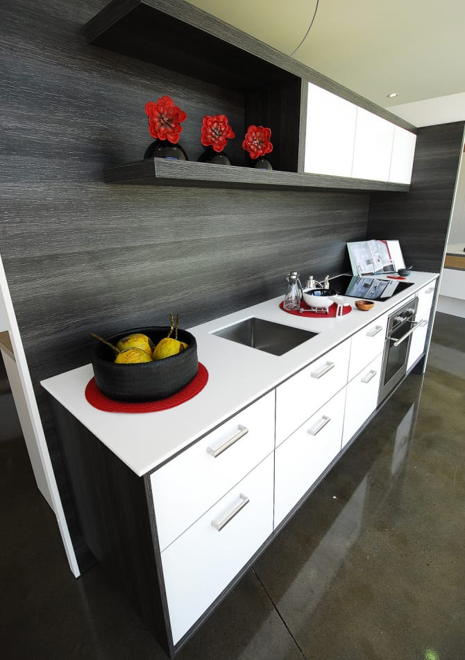 Clean white solid surface stands out against the dark background