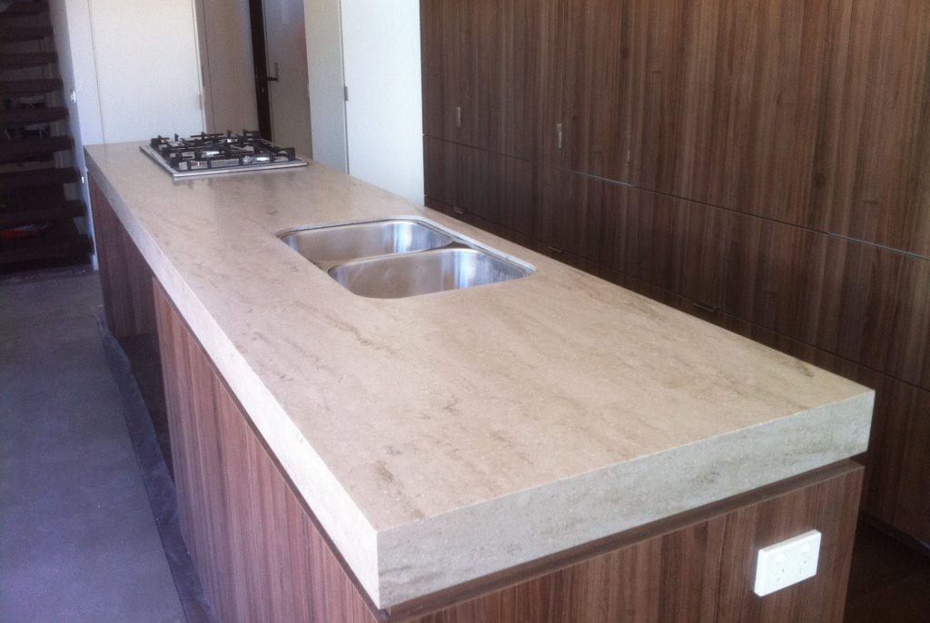 Veined colour benchtops go well with timber doors.