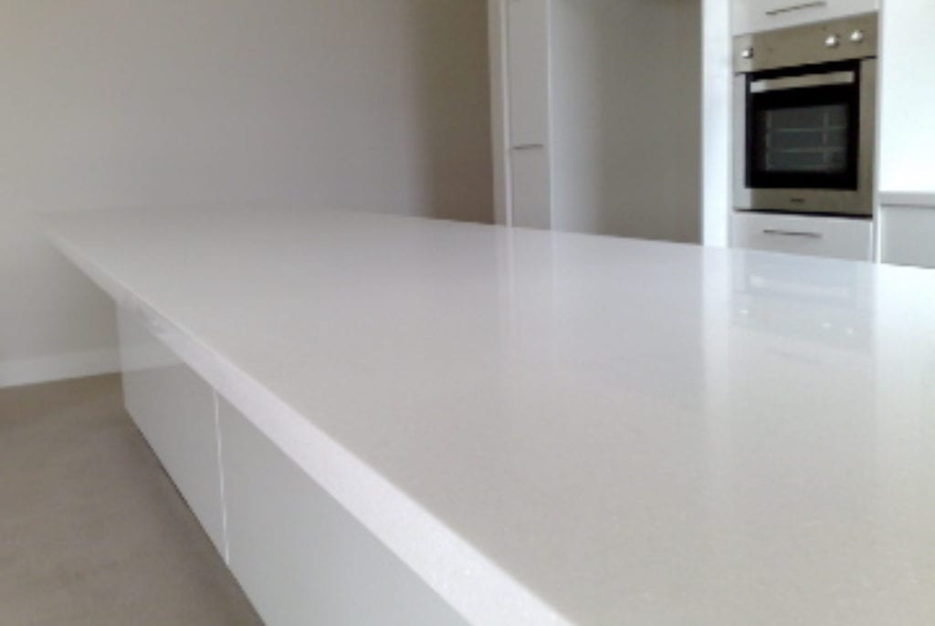 Nothing beats solid surface when it comes to large seemless tops.
