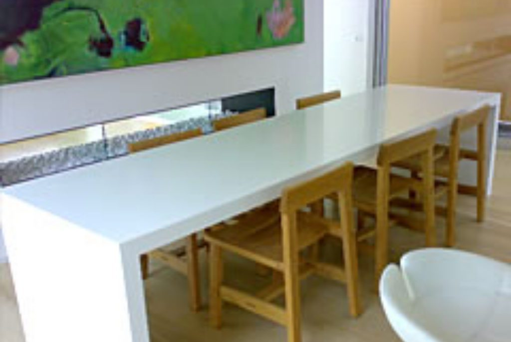 Dining table with slab ends in Corian Glacier White